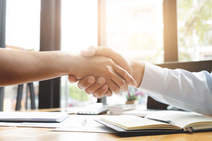 recruitment and interview concept , candidate with human resource manager handshaking.